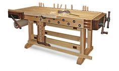 "Woodworker: Greg Scala  Scala knew that he needed a workbench that was dead-flat, sturdy, equipped with good vises, and built at the right height for his 5-ft.-9-in. frame. He also wanted a board jack, a Veritas twin-screw end vise, lots of benchdogs, and a vintage feel. He modeled his maple and walnut bench (34-in. wide by 82-in. long by 32-1/2-in. tall) after Lon Schleining's ""Essential Workbench"" in FWW #167  I want someting like this"