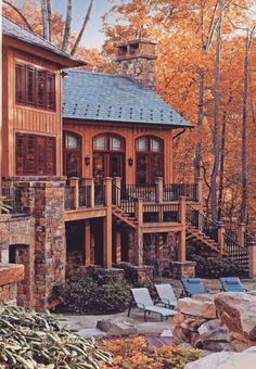 Amazing backyard. The wood of the house blends in with the trees.