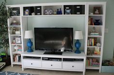 DVD Organization - how to organize dvd cases when you have a ton of movies - this entertainment center is the Hemnes from Ikea! Ikea Living Room Storage, Living Room Shelves, Living Room Modern, My Living Room, Ikea Entertainment Center, Tv Feature Wall, Ikea Home, Hemnes, Living Room Lighting
