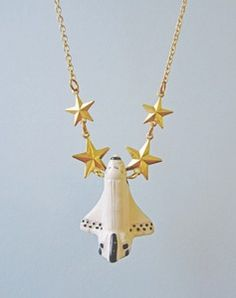 We'd love to wear this To Infinity... and beyond! Eclectic Eccentricity Space Shuttle Necklace