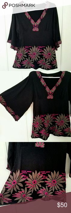 BCBG MAXAZRIA Boho Embroidered Bell Sleeve Top BCBG MAXAZRIA bohemian style bell sleeve top with floral embroidery.  3/4 length sleeves.  Black top with brown and purple embroidery.  The purple looks pink in the pictures, but the color is actually purple.  Small hole towards the bottom on the front in the embroidered part (shown in last picture).  Hardly noticeable and could most likely be fixed.  Otherwise excellent condition!  Size Large  100% Cotton BCBGMaxAzria Tops