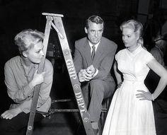 Kim Novak visits Cary Grant and Martha Hyer on the set of Houseboat (1958).