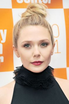 10 chic topknots to try on a hot summer beach day: Elizabeth Olsen