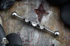 Steel industrial barbell with black and clear gems