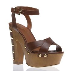 """Kicks that kick it back to Candies old school style. The Aisha from ShoeDazzle rocks a brown faux leather and 5.5"""" platform heel."""