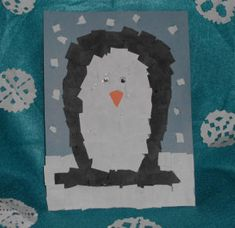Fun winter arts and crafts project for kids to make, a torn paper penguin collage project.