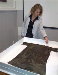 Marianne Vedeler of Norway's Museum of Cultural History shows off a 1,700-year-old tunic used as warm outer clothing, found in the mountains of southern Norway in 2011, in Oslo March 21, 2013. I have been waiting to see this picture all day! Enjoy! :)