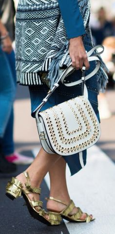 A studded white messenger.