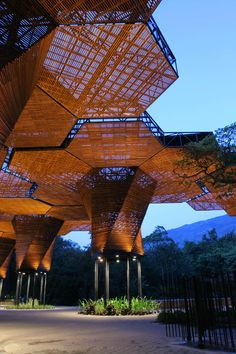 FIRM: plan:b arquitectos;  PROJECT: Orquideorama;  LOCATION: Medellín, Colombia.  A modular wooden canopy for the Medellín Botanical Garden that interlocks with the existing tree canopy and creates a multipurpose   event plaza space for residents.