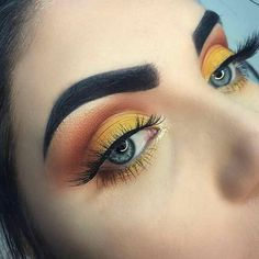 yellow and orange eye make up