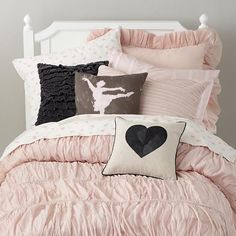 We've updated our Antique Chic Collection with the addition of I Heart Sheets. The feature a soft pink heart pattern and will mix in with many bedding sets. The addition of some greys and blacks in the throw pillows balance out the look.