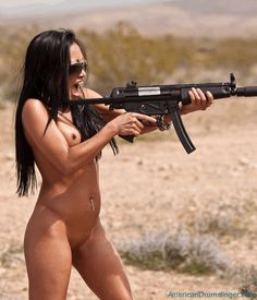 Have nude girl with a gun for