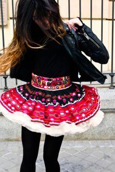 leather jacket + patterned skirt.