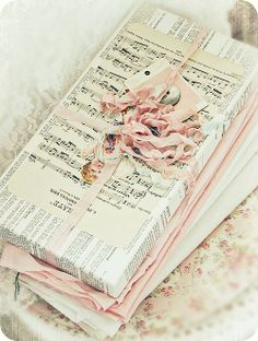Adorable packaging with sheet music, book pages and pale pink seam binding.