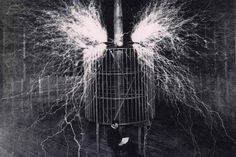 Nikola Tesla at his Colorado Springs lab while millions of volts crackles around him, 1899