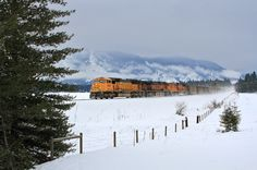 https://flic.kr/p/ADu2RK   Coal and veiled mountains   A BNSF coal train kicks up snow west at Trout Creek, Montana, on the cold winter morning of February 10, 2014,