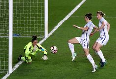 Lucy Bronze of England beats goalkeeper Manuela Zinsberger of Austria to score their second goal during the Women's International Friendly match between England and Austria at Stadium mk on April 10, 2017 in Milton Keynes, England.