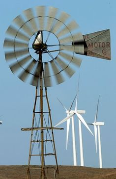 2010 photo, a working wind mill turns with a background of wind turbines from the Smoky Hills Wind Farm near Ellsworth, Kan. Would still take a windmill over a turbine any day Farm Windmill, Wind Farms, State Of Kansas, Water Wheels, Wind Mills, Wind Of Change, Water Powers, Water Mill, Old Farm