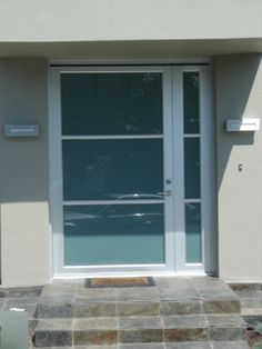 """Model: BP-450 Double Entry Door   Size: 5′ x 7′ Frame: Clear Anodized Aluminum Glass: 1/4"""" Laminated Obscured: Solex Location: Pacific Palisades, CA 90272"""