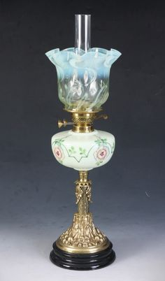 A GOOD VICTORIAN VASELINE GLASS OIL LAMP