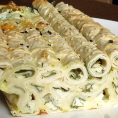 Börek | 27 Delicious Turkish Foods Everyone Must Try-Turkish savoury pastry comes in many varieties, most popularly filled with minced meat or spinach and cheese. Börek can be rolled, served as puffs, or layered like lasagna, and served for breakfast, lunch, dinner, or snack. Anyway you have it, börek is always flaky and delicious.