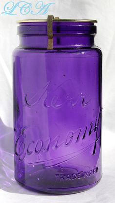 A quart size (just under 7) beautiful DEEP AMETHYST color antique glass canning jar. This is NOT a reproduction, but a GENUINE 100 year old