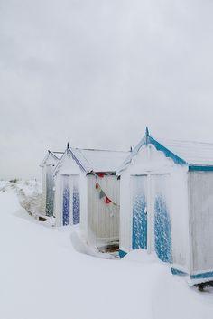 Pristine snow drifts around beach huts, Southwold, via Flickr.