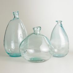 World Market - Available in multiple sizes, our recycled glass vases from Spain lend organic style with their subtle texture and unique shape.