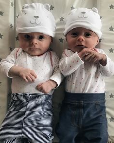 I can't work out if they love or hate their hats.