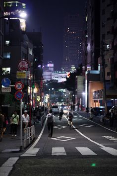 Shibuya street at night in Tokyo, Japan. This area is known as one of the fashion centers of Japan, particularly for young people, and as a major nightlife area. Photo by drkigawa on Flickr.