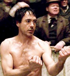 Sherlock Holmes distracting his boxing opponent by flashing his puppy-dog eyes.