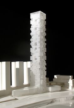 High-Rise LogicThe design of the Chongqing River Tower represents a delicate balance between simplicity and controlled complexity. SOM created this model in 2010 to demonstrate the concept design for the 300-meter building, sited opposite the dense downtown peninsula of Chongqing, China. In order to address the need for efficient, repeatable floor plates, while meeting the city's desire for an iconic form in an emerging district, SOM developed a modular design that creates human-scale ...