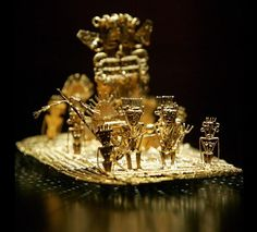 The scene depicted in this ancient artwork, on display at the Gold Museum in Bogota, Colombia, shows the origin of the El Dorado myth.  The Muisca people