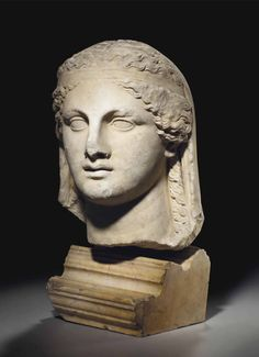 A GREEK MARBLE HEAD OF A GODDESS HELLENISTIC PERIOD, CIRCA 3RD-2ND CENTURY B.C.