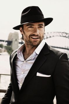 The hat looks good with facial hair. Pocket squares can sometimes be too formal, but the flat lines of this pocket square give a more casual vibe.