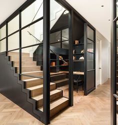 Basement joinery, stairs and home office. Crittall screens divide the room, with wooden parquet floor to guide you around the space. Finch House, 2016