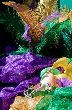 Mardi Gras colors, masks and feathers