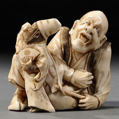 Ivory Carving of a Man, Japan, 19th century, singing, seated with a monkey on a leash in dancing and holding a folding fan in his left hand, ht. 2 1/4 in.