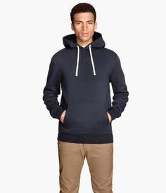 Long-sleeved sweatshirt with a lined drawstring hood, kangaroo pocket at front, and ribbing at cuffs and hem. Brushed inside.