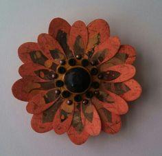 Orange Mixed Media Flower by Jennifer Nichols. Paper, wood, metal, rubber, paint. SOLD