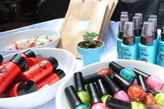 Finding a unique shower favor is always a challenge. I loved this idea: Val filled bowls with mini beauty products like colorful nail polishes, hair powder, shine gels and yummy moisturizers. Guests were given a bag and got to take home whatever products they liked.