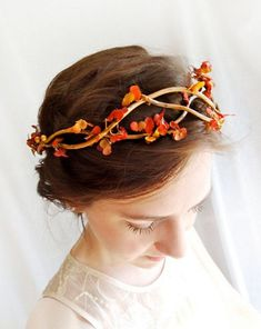 For the autumn bride this vine wreath headpiece from thehoneycomb via etsy captures the warm fall colors with burnt orange and gold leaves. #fall #headpiece #hairaccessories