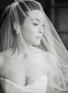 Elegant black + white bridal portrait: http://www.stylemepretty.com/destination-weddings/2016/06/28/see-how-this-couple-brought-the-french-glamour-to-shanghai/ | Photography: Jada Poon Photography - http://www.jadapoonphotography.com/