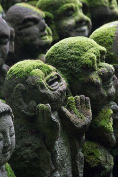 Ruins. Buddhist monk statuettes.