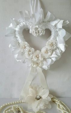Check out this item in my Etsy shop https://www.etsy.com/uk/listing/246375532/white-satin-bridal-heart-wedding