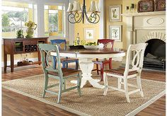 Tempting fresh colors and delightful country styling make the California Cottage dining set a charming choice. Four Provence chairs with a delightful blue finish and fruitwood seat surround the table's antique white pedestal base and contrasting fruitwood top with cherry veneers. It's a warm look you'll love having in your home.