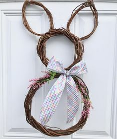 Check out this #DIY #Easter wreath idea with a twig bunny. Love it! #HomeDecorIdeas @istandarddesign