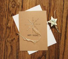 Stitch jute on a card in a snowflake pattern. This is how I like my Christmas—simple, natural and elegant.