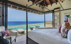 dreamy villa bedroom with water view and patio