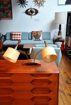 Mid-century modern...well, everything, but get a load of that dresser in the foreground! And the lamp!